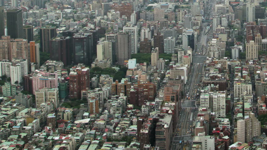Time-lapse aerial view of traffic on busy city street, zooms out to show urban sprawl and storm skies | Shutterstock HD Video #10008884