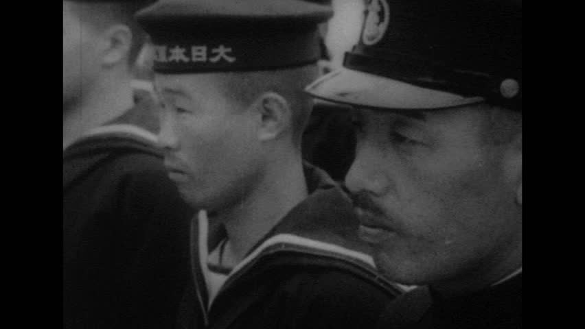 UNITED STATES 1940s: Montage of views of Japanese soldiers / Close up of Japanese soldier superimposed over soldiers marching. | Shutterstock HD Video #10011005