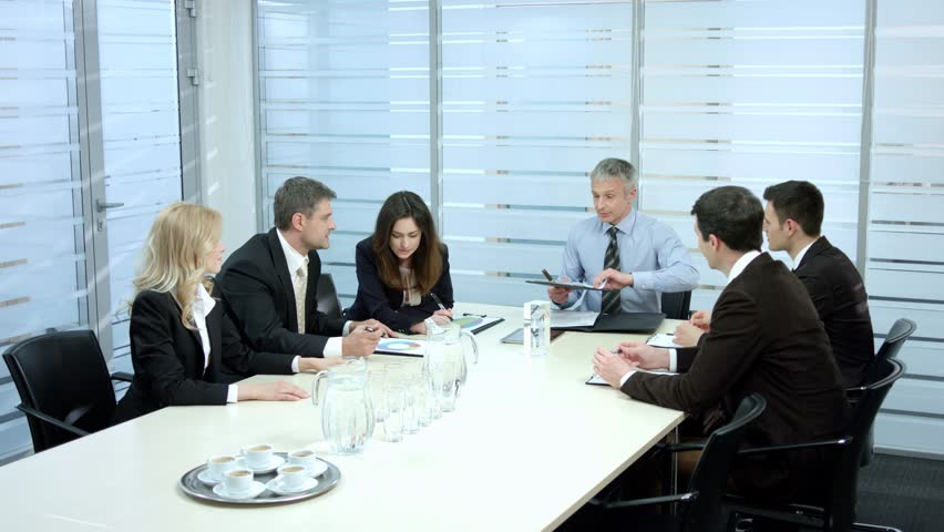 Glass office interior. Business meeting. Businessmen discussing a contract. | Shutterstock HD Video #10021145