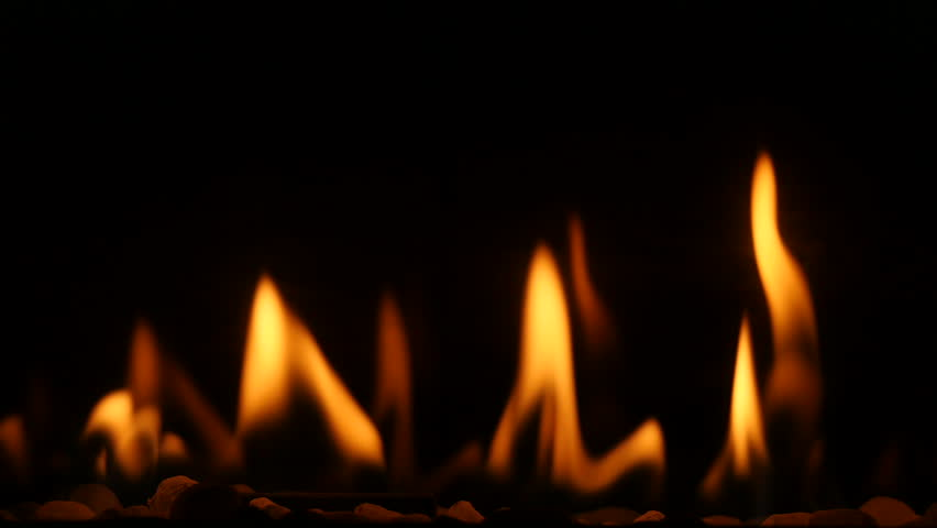 Close up of a gas fireplace burning with warm and comforting flames