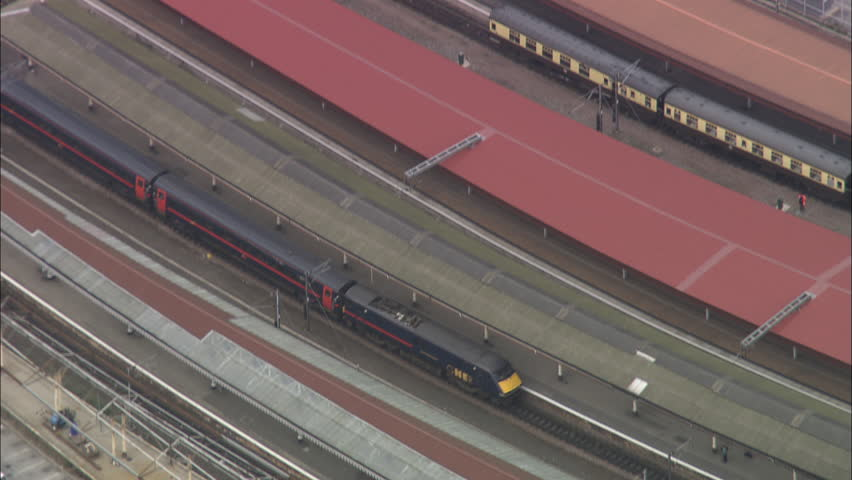 AERIAL United Kingdom-York 2005: train pulling into York station C/U then zoom out | Shutterstock HD Video #10058795