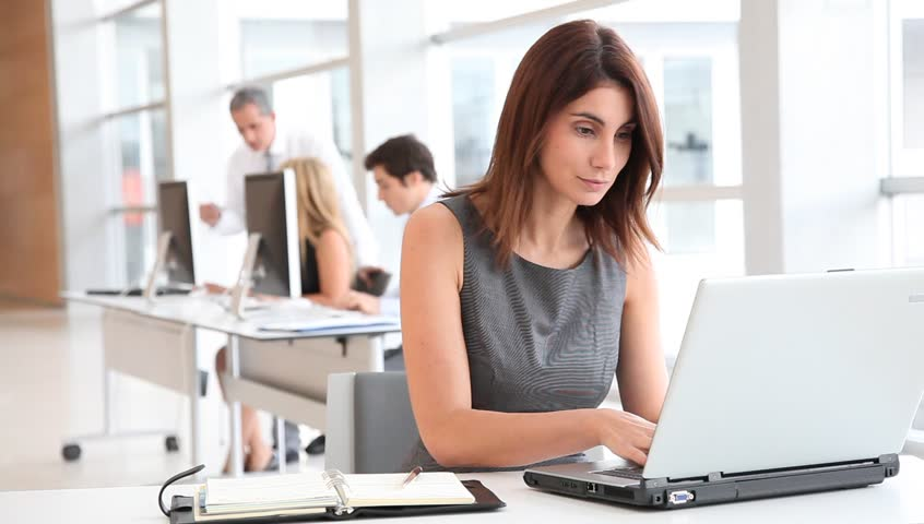 Businesswoman in office with laptop computer