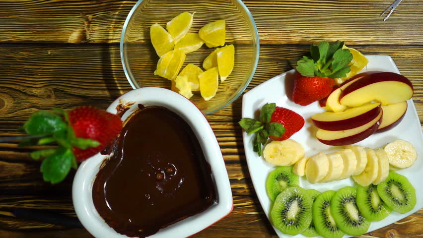Fondue with chocolate and fruits