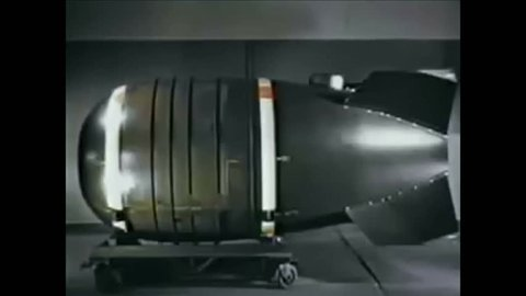 CIRCA 1953 - The Mark V atomic bomb is shown and its design explained.