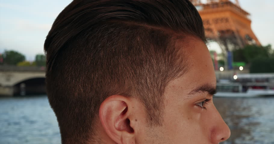 Close up of Latin male with cool undercut standing near Eiffel Tower. Attractive millennial with trendy haircut in Paris. 4k | Shutterstock HD Video #1006650745