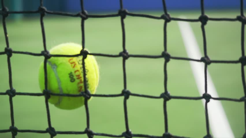 Tennis ball hits the grid falling on a tennis court in slow motion. 1920x1080