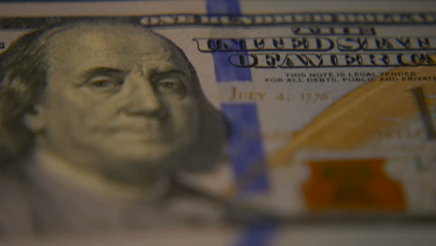 Dollar bills close-up. Macro photography of bank notes. Portrait of George Washington.   Shutterstock HD Video #1006680685