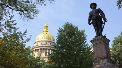 CHARLESTON, WEST VIRGINIA - CIRCA 2010s - A Confederate statue stands in front of the capital building in Charleston, West Virginia.