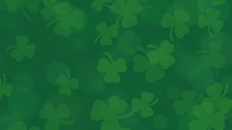 St Patrick's Day animated shamrocks on a deep green bokeh background.