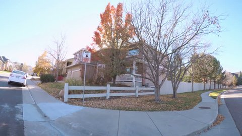 Denver, Colorado - October 21, 2017. POV point of view - Driving through typical suburban residential neighborhood in Autumn.