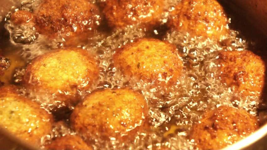Falafel boiling in the oil,  Cooking falafel fresh