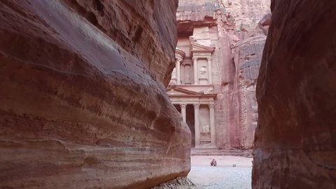 Petra - ancient city, view of Treasury from As Siq gorge  with camels in front of facade. Jordan.