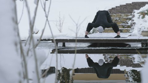 A man is meditating in nature in the winter. Yoga.