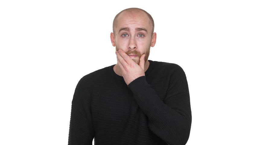 Portrait of adult bald man being surprised and shocked covering open mouth with hand, feeling horror over white background. Concept of emotions