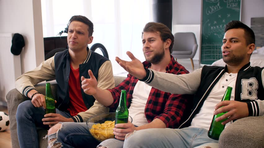 Outraged football fans at super bowl party