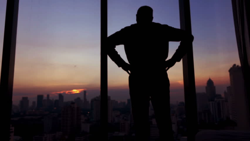 Young man  walk to the window and enjoying sunset in the city, 120fps #1006919935