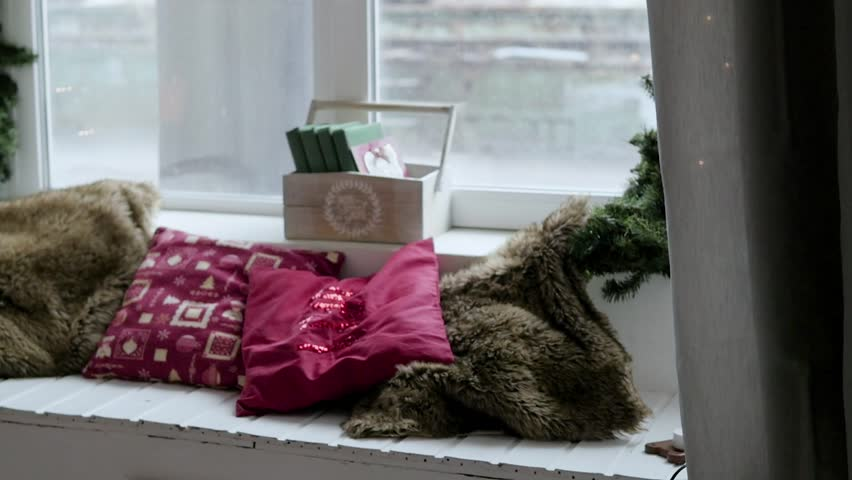 Christmas interior on the window of the house. A cozy corner in the studio | Shutterstock HD Video #1006934965