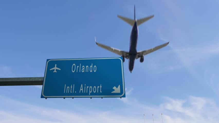 orlando airport sign airplane passing overhead