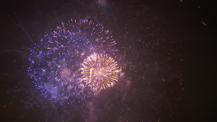 A steady zoomed in shot of circular forming fireworks in Australia during New year's eve. | Shutterstock HD Video #1006991305