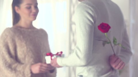 Valentine Gift. Happy Young Couple with Valentine's Day or birthday Present. Happy Man giving a gift to his Girlfriend. Love concept. Holiday. Slow motion 240 fps. 4K UHD video