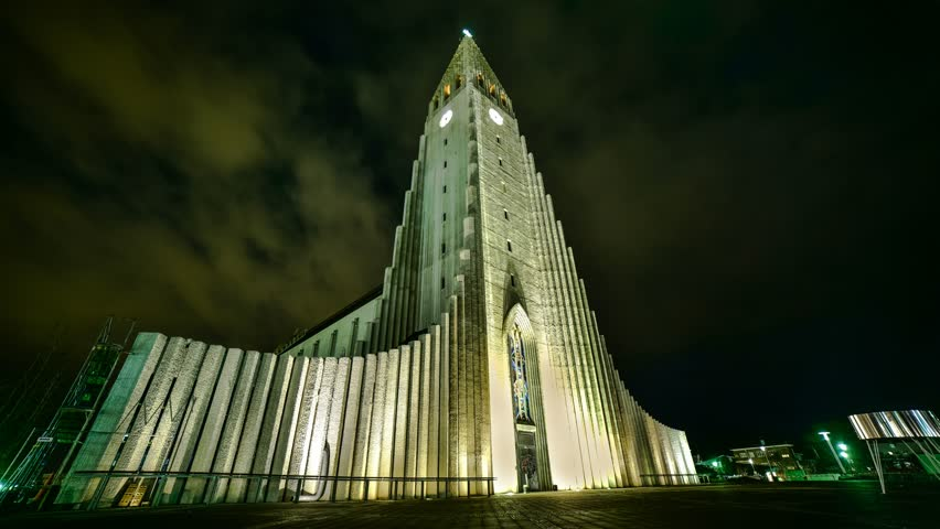 Reykjavik church at night - moving clouds and aurora borealis time lapse
