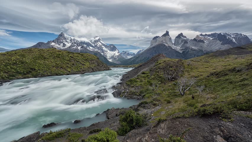 Timelapse from the Rio Torres in front of the Torres del Paine Nationalpark in Southern Chile. Patagonia landscape mountains andes peaks outdoor hiking travel explore cloud formation long exposure