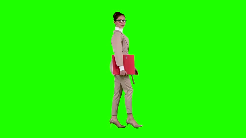 Businessman is going to a meeting with a red folder. Green screen. Side view. Slow motion | Shutterstock HD Video #1007063845