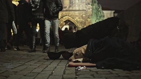 Prague, Czech Republic- December 25, 2017: Homeless with dog on street