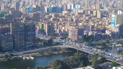 CAIRO, EGYPT - DECEMBER 24, 2017: Aerial view on buildings of Giza, 6th of October bridge and Nile river from the top of Cairo Tower, located on Gezira Island, on December 24 in Cairo