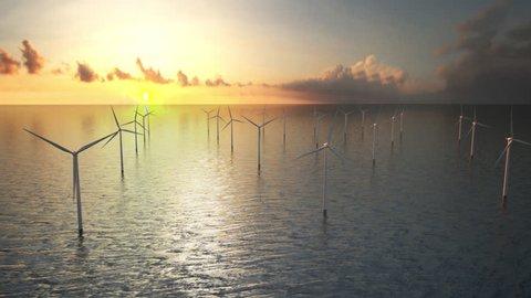 Offshore wind turbines at sunset. Wind Farm, renewable energy.