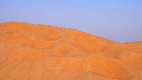 Sand surface on desert dunes. High sand dunes in wild desert panoramic view
