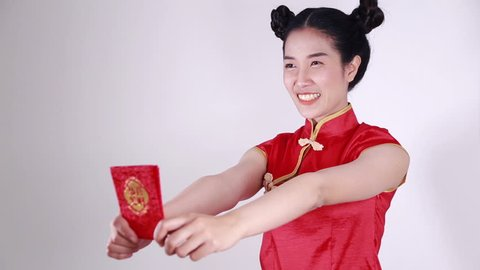 woman wear cheongsam and holding red envelope in concept of happy chinese new year
