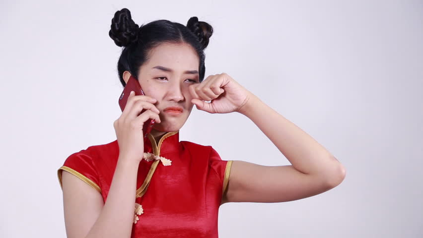 crying woman wear cheongsam and using mobile phone