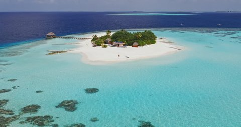 Aerial drone view of couple on a tropical island in the Maldives
