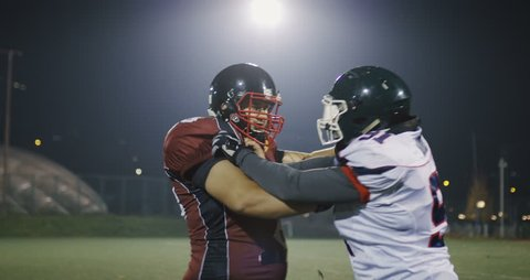 -Slow motion football players fight