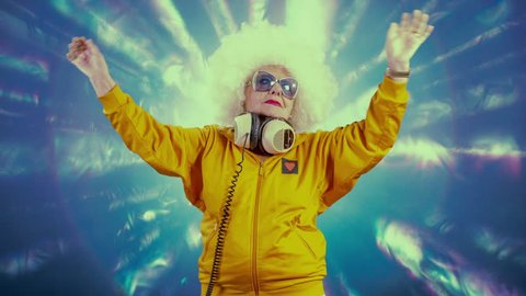an amazing grandma disco dancer and dj, older lady partying in a hypnotic colourful disco setting.