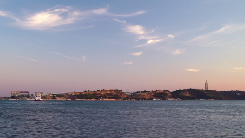 Panoramic view of Tagus river left coast and Christ the King statue during sunset, Lisbon, Portugal