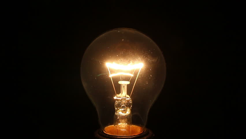 Incandescent lamp on isolated black | Shutterstock HD Video #1007457925