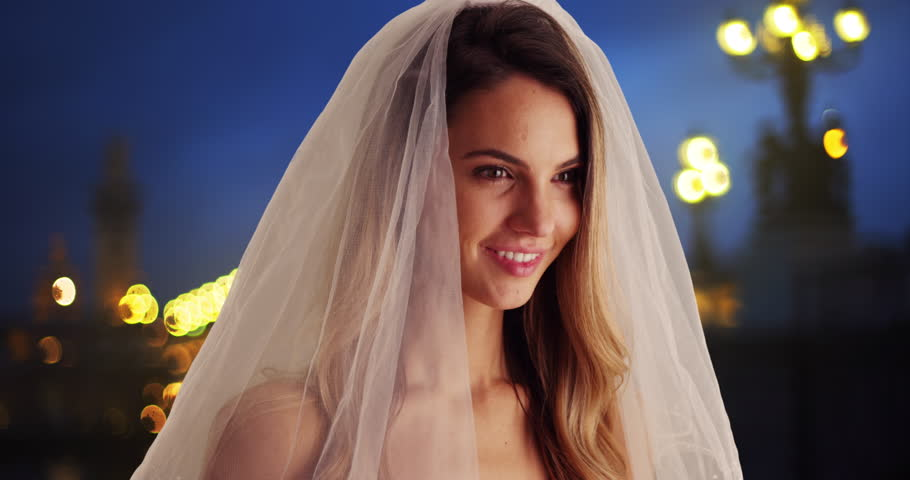 Close up portrait of blushing bride in Paris. Beautiful bride outside at night smiling at camera. 4k | Shutterstock HD Video #1007462365