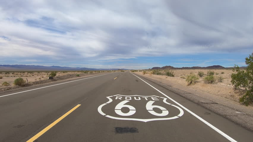 Aerial view of Route 66 pavement sign in the vast California Mojave desert.