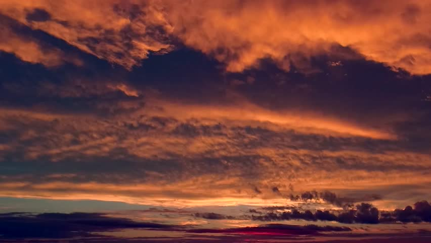 Sunset Cloud Time Lapse, Aerial pan shot over clouds during beautiful sunset time-lapse, Red purple orange blue pink sunset sky cloud, Purple sky clouds afterglow dusk evening, ULTRA HD, 4K.