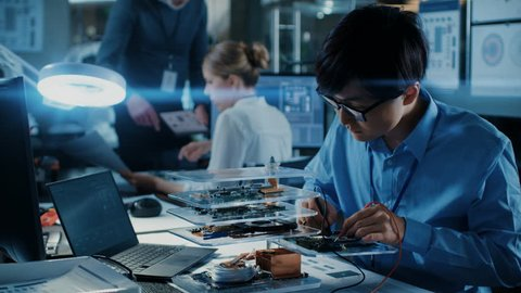 Team of Computer Engineers Work with Three Dimensional Printer, They've Created Unique Component. They Work in a Creative Scientifically Advanced Laboratory. Shot on RED EPIC-W 8K Helium Cinema Camera