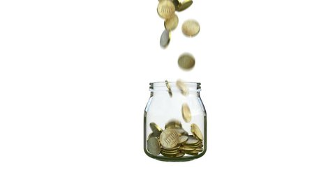coins fill a glass jar