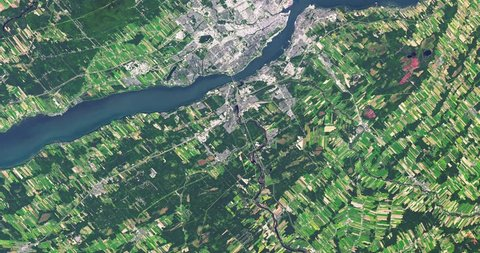 Very high-altitude overflight aerial of Quebec City, Canada. Clip loops and is reversible. Elements of this image furnished by NASA
