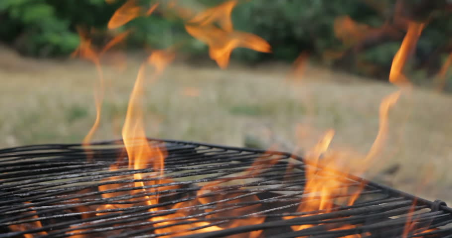 Video of fire brown wood dark grey black coals on bright yellow fire inside metal brazier. Wood burning in the braziers. Flames fires preparation for cooking barbecue. Brazier of nature bbq background