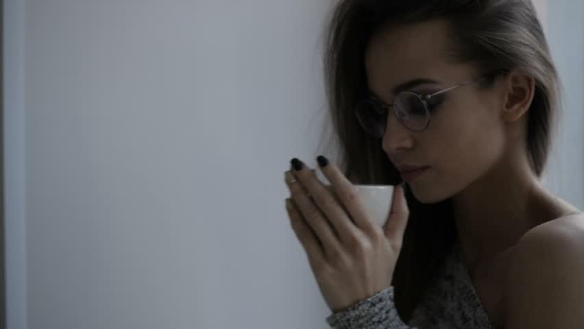 Attractive girl is drinking tea | Shutterstock HD Video #1007549365