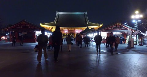 TOKYO, JAPAN - CIRCA MARCH, 2017: POV Walking in Senso Ji Temple at night. The Senso-ji Temple is the symbol of Asakusa and one of the most famous temples in Japan.