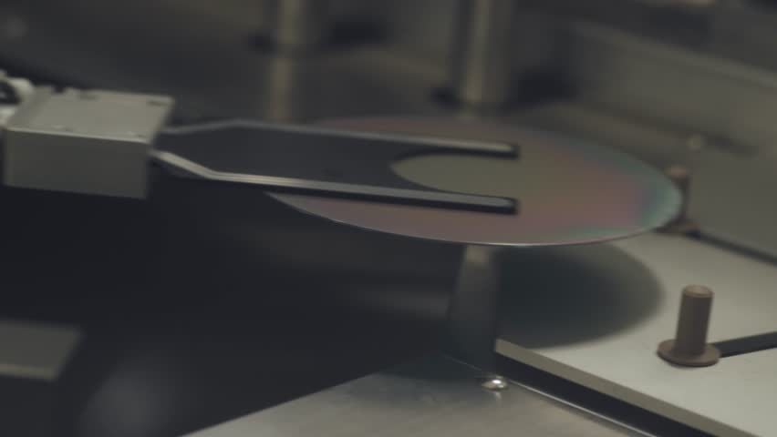 Innovative laboratory, automatic machine produces polishing of silicon wafers.  | Shutterstock HD Video #1007560705