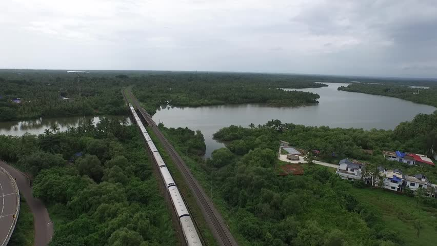 Aerial view of train passing near backwaters