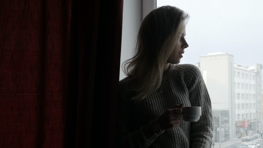 Girl is drinking coffee on window sill | Shutterstock HD Video #1007602495